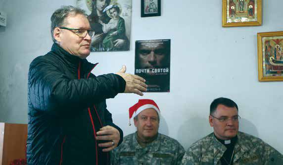 Hannu ministering in a worship service in the town of Pavlopol. The surrounding area is under artillery fire on a daily basis.