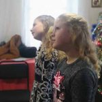 Children take part in the Christmas program.